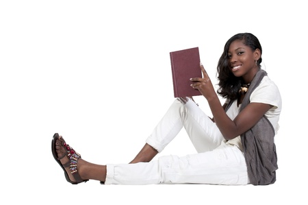 student reading: A young African American teenage woman reading a book