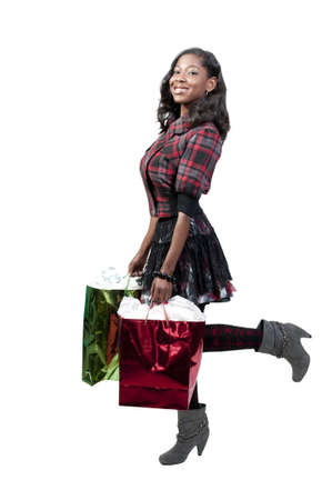 buying: A young beautiful black African American teenage woman on a shopping spree