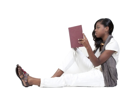 A very beautiful African American black woman teenage student reading a book