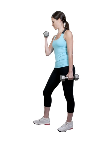 woman lifting weights: A beautiful young woman using weights during a workout