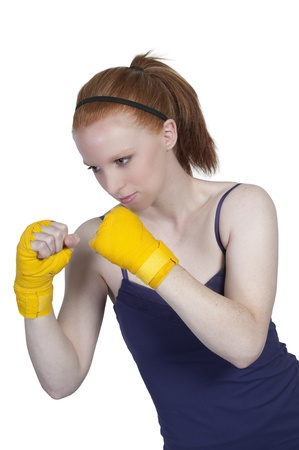 A beautiful young woman wearing a pair of boxing gloves Stock Photo - 10196309