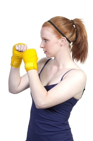 A beautiful young woman wearing a pair of boxing gloves Stock Photo - 10196319