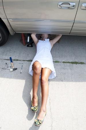 A beautiful female mechanic working on an automobile Stock fotó