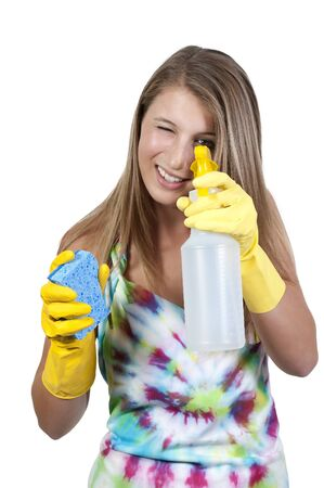 Aglove wearing beautiful woman or maid cleaning house with a sponge and spray bottle with cleaner Stock Photo - 10191804