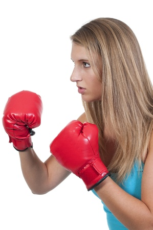 A beautiful young woman wearing a pair of boxing gloves Stock Photo - 10196349