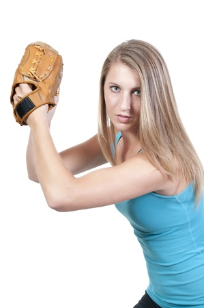 A beautiful woman baseball pitcher getting ready to throw a ball in a game