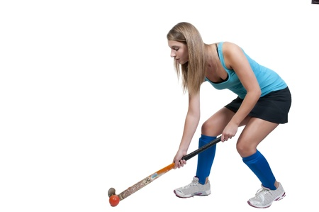 hockey player: A beautiful young woman field hockey player