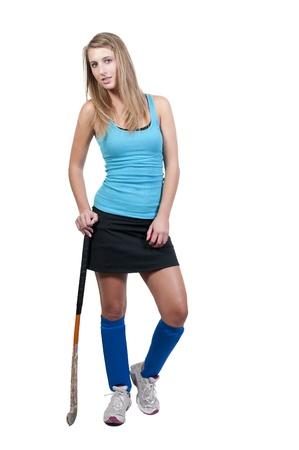 Een mooie jonge vrouw hockeyspeler