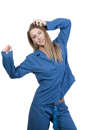 A young stretching woman waking up in her pajamas in the morning Stock fotó