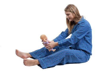 babydoll: A young Beautiful Woman playing with a baby doll Stock Photo