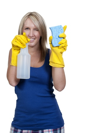 Aglove wearing beautiful woman or maid cleaning house with a sponge and spray bottle with cleaner Stock Photo - 10197839