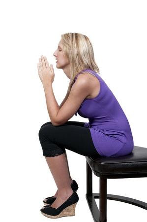 Beautiful Christian woman in a deep prayer 写真素材