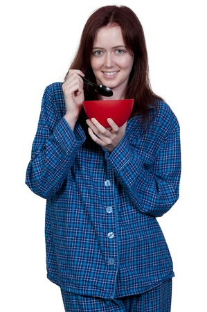 A beautiful woman eating food from a bowl Stock Photo - 10258667