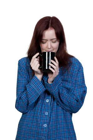 night shirt: A beautiful young Asian ethnic woman drinking coffee in her pajamas