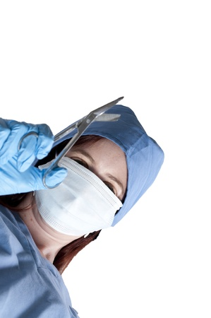 A beautiful young woman surgeon performing surgery Stock Photo - 10258954