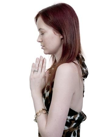 Beautiful Christian woman in a deep prayer Stock Photo - 10197720
