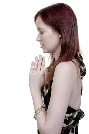 kneeling woman: Beautiful Christian woman in a deep prayer Stock Photo