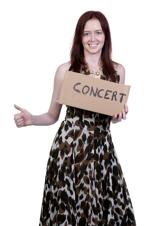 A beautiful woman with a sign hitch hiking to a concert Stock Photo - 10197662
