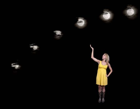 A beautiful woman displaying a series of full moons across the night sky photo