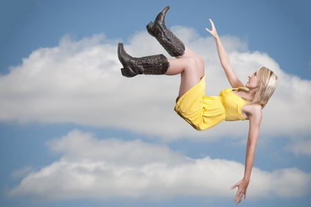 A beautiful young woman falling through the sky Stock Photo - 10197663