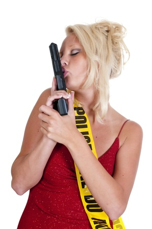 45 caliber: A young and beautiful woman holding and kissing a handgun wearing police line tape as a sash