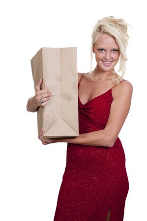blonde minority: A beautiful young woman on a grocery shopping spree holding a brown paper bag
