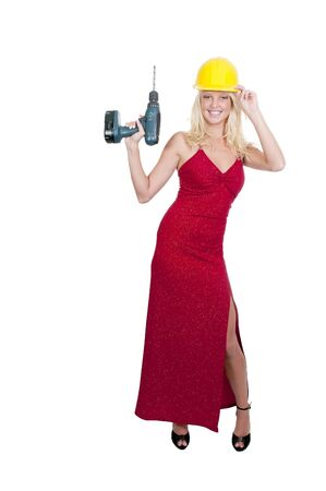 architect tools: A beautiful woman in an enening gown with a hard hat and cordless drill