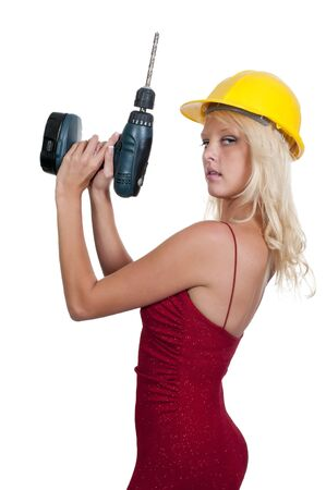drill bit: A Female Construction Worker holding a cordless drill