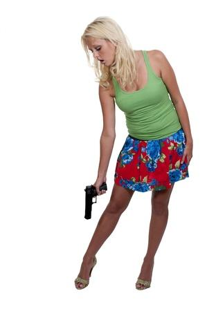Een mooie vrouw schieten zichzelf in de voet.