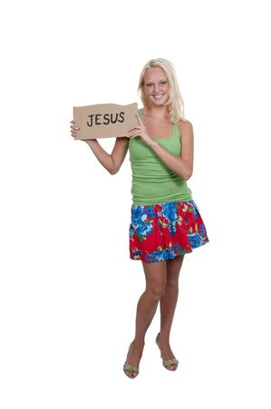 A beautiful young woman holding up a Jesus sign Stock Photo - 10258972