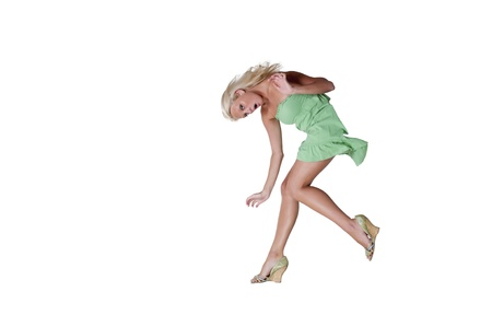 A beautiful woman as she slips trips and falls Stock Photo - 10196377