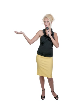 A beautiful young woman newscaster broadcasting the news with a microphone photo