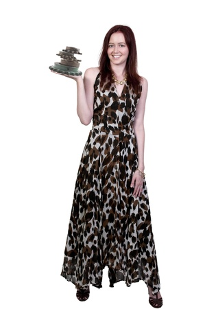 sprockets: A young Beautiful Woman holding a stack of industrial sprockets