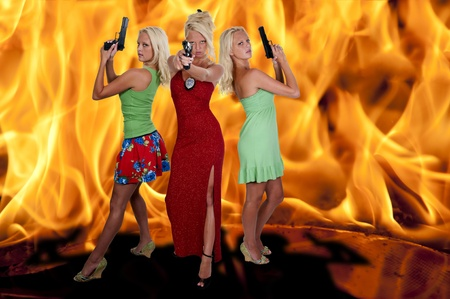 sexy police: Beautiful sexy police women detectives standing in front of a blazing fire