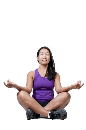 A beautiful Asian woman doing her Yoga Imagens - 10196406