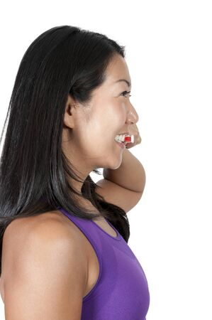 A beautiful Asian woman practicing good oral dental care by brushing her teeth Stock Photo - 10255512