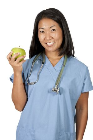 An Asian female cardiologist holding a red heart Stock Photo - 10254818