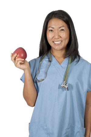An Asian female cardiologist holding a red heart Stock Photo - 10220887