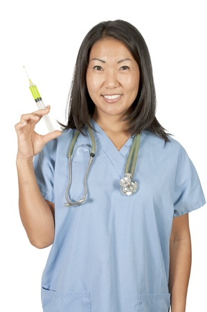 A young beautiful Asian woman doctor in scrubs with a medical syringe with medicine photo