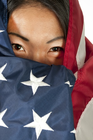 An Arab woman wrapped in an American flag photo
