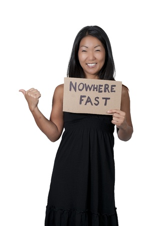 hitch hiker: A beautiful young Asian woman holding up a sign that says Nowhere Fast