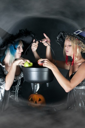 caldron: A couple of beautiful young women witches on Halloween