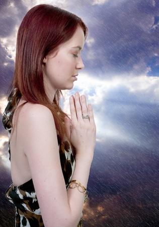 Beautiful Christian woman in a deep prayer Stock Photo - 10304547