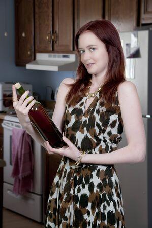 A beautiful  woman holding a wine bottle  photo