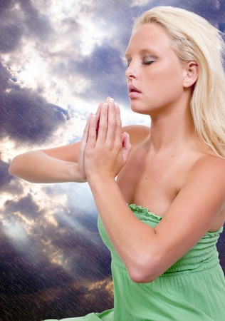 Beautiful Christian woman in a deep prayer photo