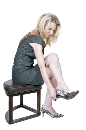 A beautiful young woman putting on her shoes photo