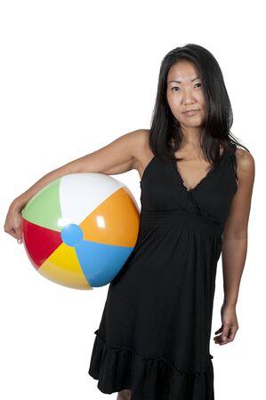 beachball: A beautiful young Asian woman holding a beachball