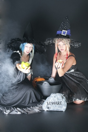 jack pot: A couple of beautiful young women witches on Halloween