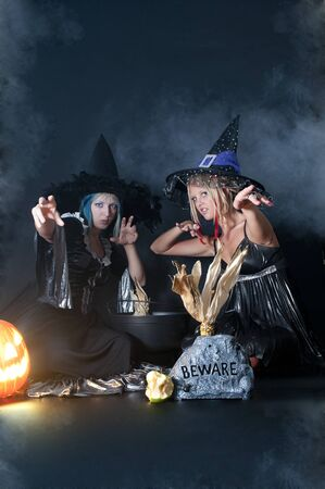 A couple of beautiful young women witches on Halloween photo