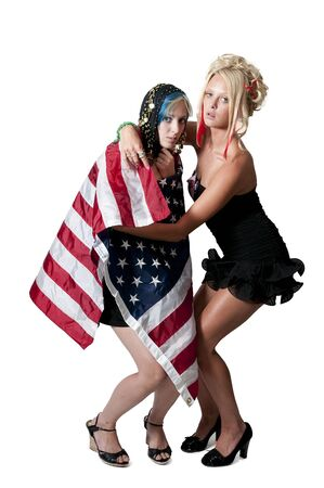 blonde minority: An Arab woman wrapped in an American flag Stock Photo